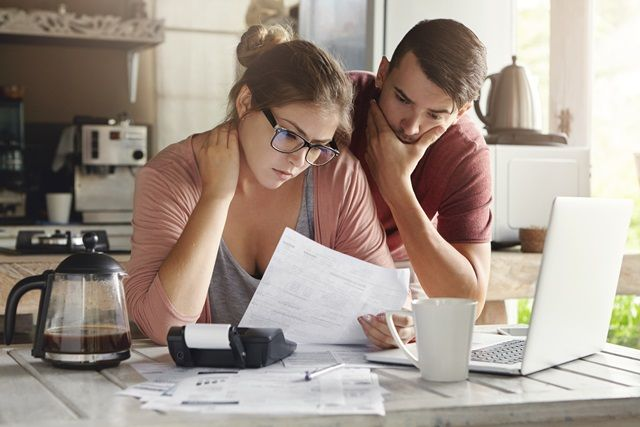 Couple looking at their family budget